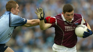 Michael Meehan pushes past Paul Griffin in the 2002 All-Ireland Under-21 final between Galway and Dublin