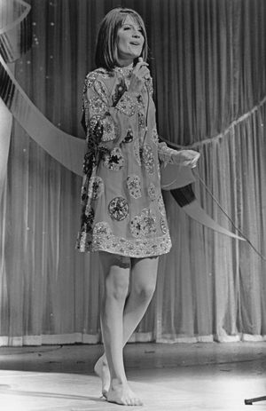 Iconic: Singer Sandie Shaw embodying the sixties spirit in an embroidered mini dress and...bare feet! This year in 1967, her song 'Puppet On A String' was the first British song to win the contest!