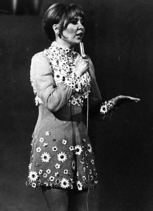 Another Sixties mini dress for British singer Lulu in 1969. The singer went floral performing her song 'Boom Bang-a-Bang' which took her to third place.