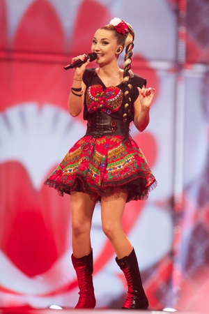 Band Donatan and Cleo from Poland performed in 2014 in traditional Polish inspired costumes. They rocked it with mini skirts and high boots!