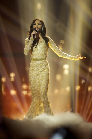 The famous Conchita Wurst wore an embroidered gold dress as she performed for Austria in 2014 and won.