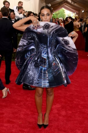 Solange attended the 2015 Met Gala in a metallic bloom dress by Giles. Theme: China: Through The Looking Glass.