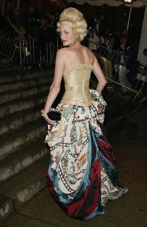 Model Amber Valletta wore a Norris Couture corset and John Galliano skirt to the 2004 Met Gala. Theme: Dangerous Liaisons: Fashion and Furniture in the 18th Century