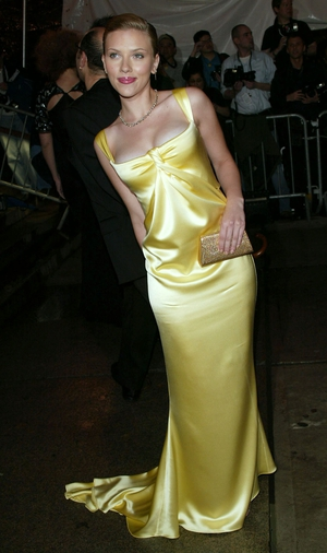 Scarlett Johansson attends the 2004 Met Gala in Calvin Klein. Theme:Dangerous Liaisons Fashion and Furniture in the 18th Century