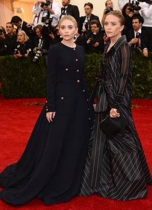 Ashley Olsen wore vintage Gianfranco Ferré while Mary-Kate Olsen wore vintage Chanel to the 2014 Met Gala. Theme: Charles James: Beyond Fashion.