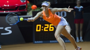 Sharapova returns Kontaveit during their quarter-final match in Stuttgart