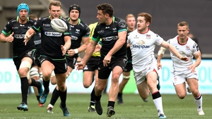 Kieron Fonotia offloads to Dan Biggar despite the attentions of Paddy Jackson