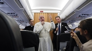 Pope Francis talks to journalists during a press conference he held on his return flight from Cairo to Rome