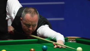John Higgins was the more composed player in the first session
