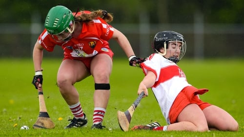 Cork's Roisin Kileen with Aimee Devlin of Derry in the Division 2 final