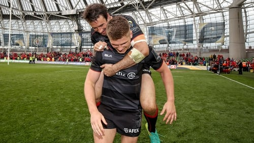 Marcelo Bosch and Owen Farrell celebrate after defeating Munster
