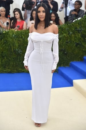 Big sis Kim Kardashian West is surprisingly demure in Vivienne Westwood.