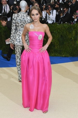 Lily-Rose Depp is a beautiful rose in this Chanel bustier dress with floral details.