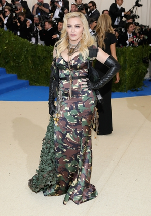 The one and only Madonna always knows how to make a splash on the red carpet! The singer/soldier wore a Moschino camo gown.