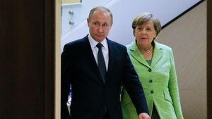 Vladimir Putin was speaking at a joint news conference with German Chancellor Angela Merkel