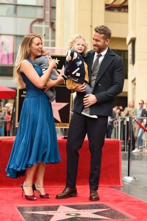 The Reynolds family pose with Ryan's star on the Hollywood Walk of Fame in 2016.