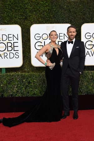 Atelier Versace velvet gown for Blake and matching bow tie for Ryan at the 2017 Golden Globes. Lovers always match!