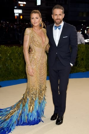 Blake Lively was mesmerizing in an Atelier Versace and Lorraine Schwartz jewelry while Ryan wore matching bow. The couple were attending the 2017 MET Gala.