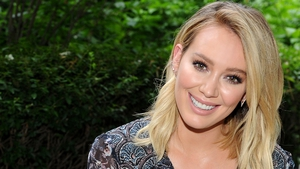 Hilary Duff just rescued an adorable little black doggy and asked her fans to help her name her new puppy.