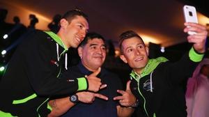 Stefano Pirazzi (l) and Nicola Ruffoni (r) take a selfie with Diego Maradona at the 2015 Dubai Tour