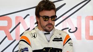 Fernando Alonso has signed a new McLaren deal