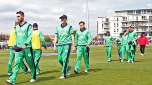 Dejected Ireland players trudge from the  Bristol Cricket Ground