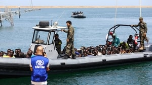 Migrants, rescued by the Libyan coastguard, arrive at the naval base in Tripoli