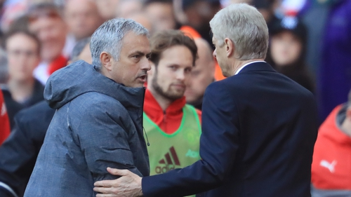 Jose Mourinho and Arsene Wenger shake hands after the game at the Emirates Stadium