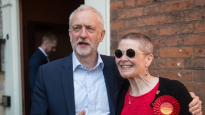 Jeremy Corbyn poses with a supporter on the campaign trail