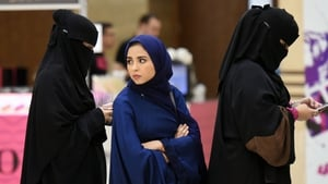 Saudi women queue to attend a performance by US dance group iLuminate in Riyadh last year