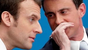 Manuel Valls (R) is the first high-profile defection since the election win of Emmanuel Macron (L) on Sunday