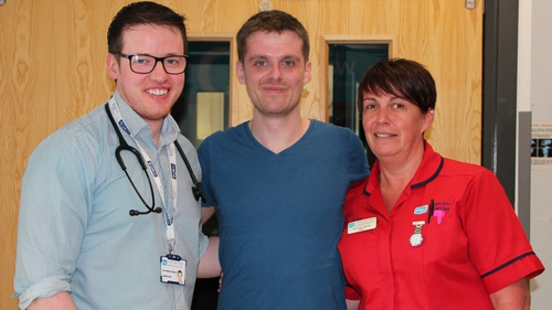 Matthew Bryce pictured with staff at the Ulster Hospital
