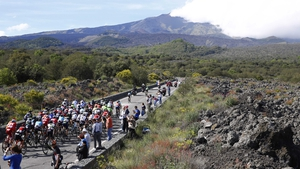 The riders race towards the active Etna volcano