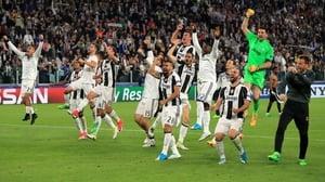 Juventus players celebrate in Turin