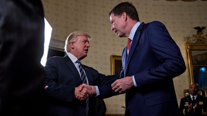 Donald Trump shakes hands with James Comey at the White House earlier this year