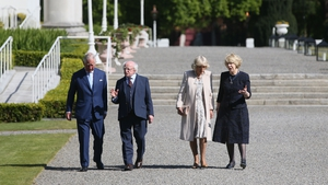 Prince Charles and the Duchess of Cornwall walk with President Michael D Higgins and his wife Sabina