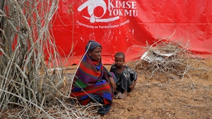 A woman and child at a camp for displaced people in the Kaxda district, on the outskirts of Mogadishu