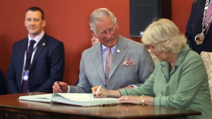 The Prince of Wales and the Duchess of Cornwall sign the visitors book in Kilkenny Castle