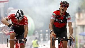 Swiss BMC rider Silvan Dillier (R) celebrates as he crosses the finish line ahead Belgian rival Jasper Stuyven