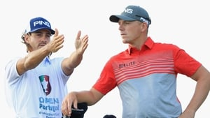 Wallace listens to the advice of his caddy in Portugal