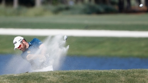 Oosthuizen shoots out of a bunker on the sixth at TPC Sawgrass