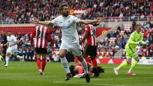 Fernando Llorente wheels away after heading Swansea in front