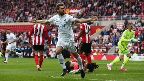 Fernando Llorente wheels away after heading Swansea in front