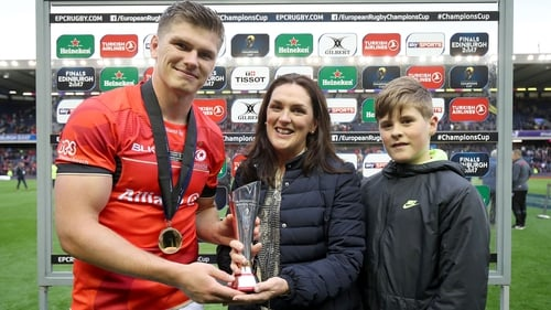 Owen Farrell is presented with the Anthony Foley Memorial Award by Anthony's wife Olive and their son Tony