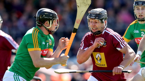 Westmeath's Robbie Greville evades the challenge of Meath's Darragh Kelly