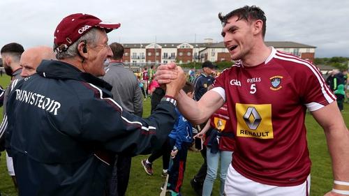 Michael Ryan () congratulates Aaron Craig after Westmeath's win against Meath