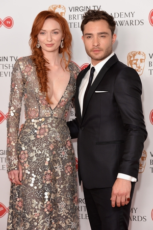 Poldark's Eleanor Tomlinson wore a sheer floral dress with plunging neckline. Here she poses next to Gossip Girl star Ed Westwick who opted for a classic black suit and tie.