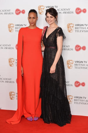 Actress Zawe Ashton (L) wore a Stella McCartney dress and Loboutin shoes while and Tuppence Middleton (R) wore an Erdem London dress and Jimmy Choo shoes.