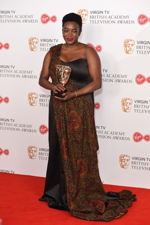 Wunmi Mosaku, winner of the Supporting Actress award for 'Damilola, Our Loved Boy', wore a floor length printed dress with one shoulder.