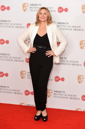 Kim Cattrall wore a simple black number with peep toe shoes and a classic white blazer.